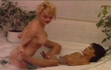 Sylvie Rauch in bathtub with a girl